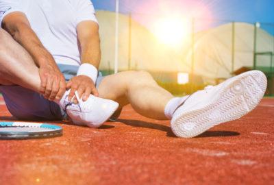 Unfallversicherung - Umknicken mit dem Fuß beim Tennisspiel als Unfall
