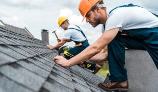 Selective,Focus,Of,Handsome,Handyman,Repairing,Roof,With,Coworker